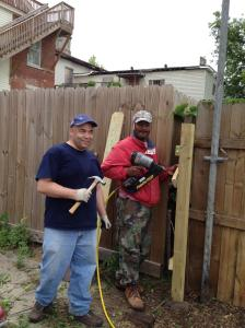Berley Green and Carlos Thibodeaux working with the United Way's Project Serve